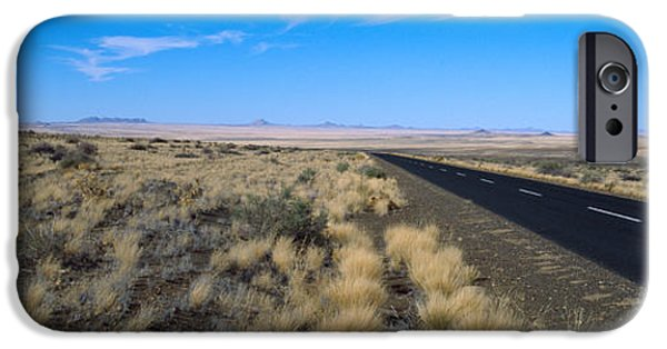 Asphalt iPhone Cases - Desert Road Passing iPhone Case by Panoramic Images