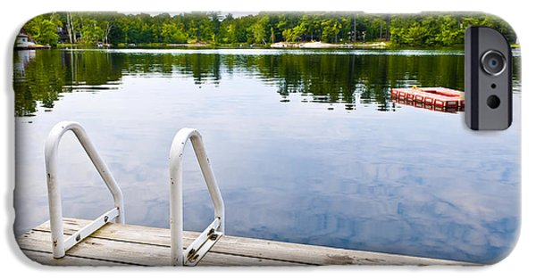 Wooden Platform iPhone Cases - Dock on calm lake in cottage country iPhone Case by Elena Elisseeva