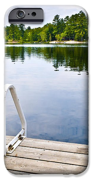 Dock on calm lake in cottage country iPhone Case by Elena Elisseeva