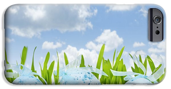 Coloured Photographs iPhone Cases - Easter eggs in green grass iPhone Case by Elena Elisseeva