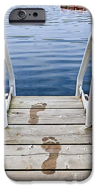 Board iPhone Cases - Footprints on dock at summer lake iPhone Case by Elena Elisseeva