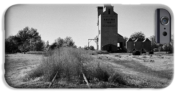 Sask iPhone Cases - grain elevator and old train track landmark bengough Saskatchewan Canada iPhone Case by Joe Fox