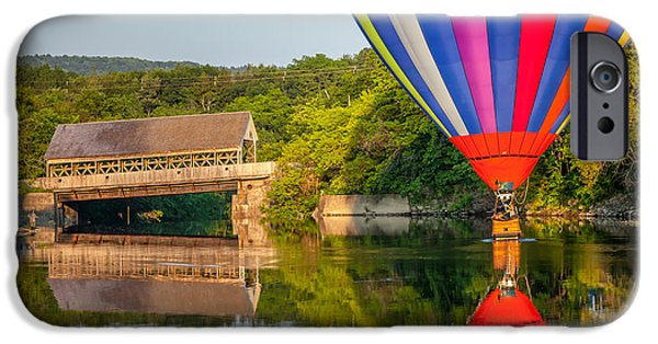 Recently Sold -  - Hot Air Balloon iPhone Cases - Hot Air Balloon Dipping near the Quechee Covered Bridge iPhone Case by Susan Cole Kelly
