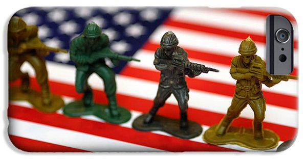 Armed Services iPhone Cases - Line of Toy Soldiers on American Flag Shallow Depth of Field iPhone Case by Amy Cicconi