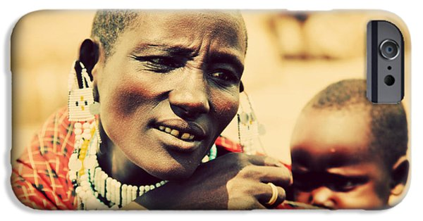 East Village iPhone Cases - Maasai baby carried by his mother in Tanzania iPhone Case by Michal Bednarek