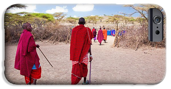 East Village iPhone Cases - Maasai people and their village in Tanzania iPhone Case by Michal Bednarek