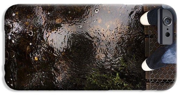 Man Looking Down iPhone Cases - Man standing on a rainforest boardwalk iPhone Case by Ryan Jorgensen