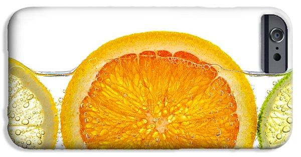 Slices iPhone Cases - Orange lemon and lime slices in water iPhone Case by Elena Elisseeva