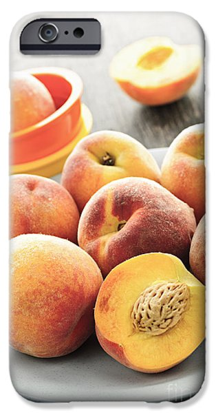 Slices iPhone Cases - Peaches on plate iPhone Case by Elena Elisseeva