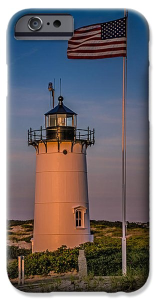 Sunset iPhone Cases - Race Point Lighthouse and Old Glory iPhone Case by Susan Candelario