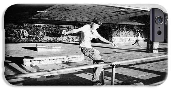 Skateboard iPhone Cases - skateboarder at the undercroft skate park of the southbank centre London England UK iPhone Case by Joe Fox