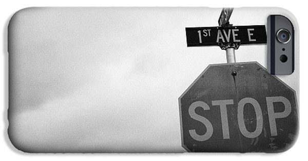 Overcast Day iPhone Cases - stop sign at junction of first street and first avenue on a cold grey day assiniboia Saskatchewan Ca iPhone Case by Joe Fox