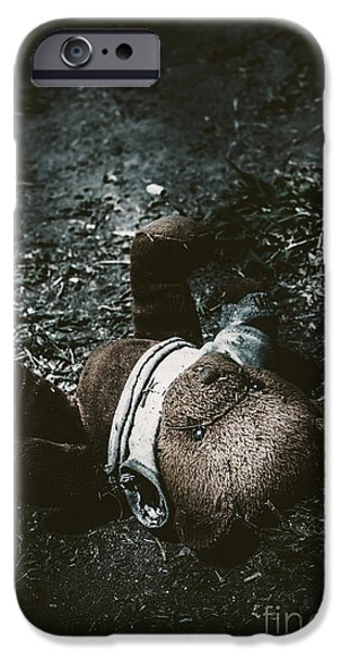 Missing Child iPhone Cases - Toy teddy bear lying abandoned in a dark forest iPhone Case by Ryan Jorgensen