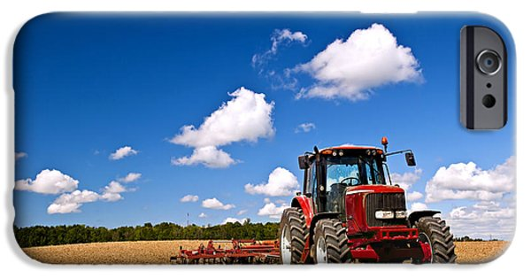 Business Photographs iPhone Cases - Tractor in plowed field iPhone Case by Elena Elisseeva