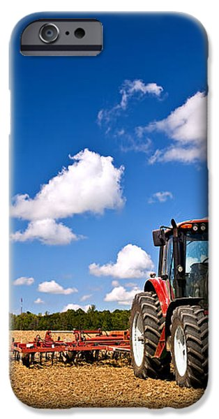Tractor in plowed field iPhone Case by Elena Elisseeva