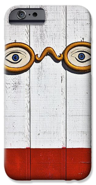 Glass Wall iPhone Cases - Vintage eye sign on wooden wall iPhone Case by Garry Gay