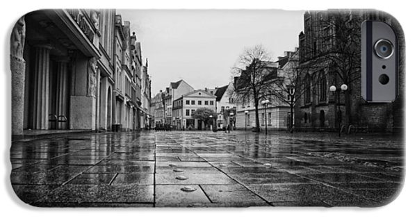 Rainy Day iPhone Cases - Wet Plaza in Gustrow Germany iPhone Case by Mountain Dreams
