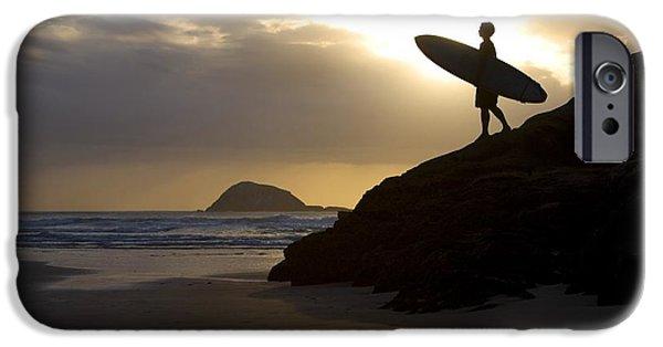 Beach Landscape iPhone Cases - A Surfer On Muriwai Beach New Zealand iPhone Case by Deddeda