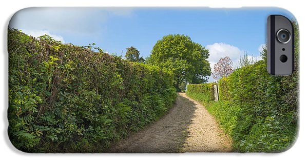 Agriculture iPhone Cases - Dirt road through the countryside in summer iPhone Case by Jan Marijs