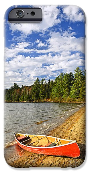Paddle iPhone Cases - Red canoe on lake shore iPhone Case by Elena Elisseeva