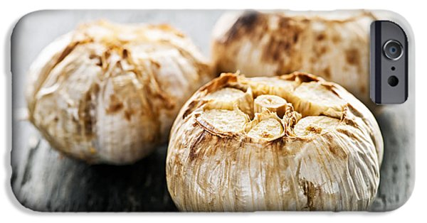 Board iPhone Cases - Roasted garlic bulbs iPhone Case by Elena Elisseeva