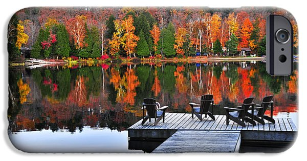 Algonquin iPhone Cases - Wooden dock on autumn lake iPhone Case by Elena Elisseeva