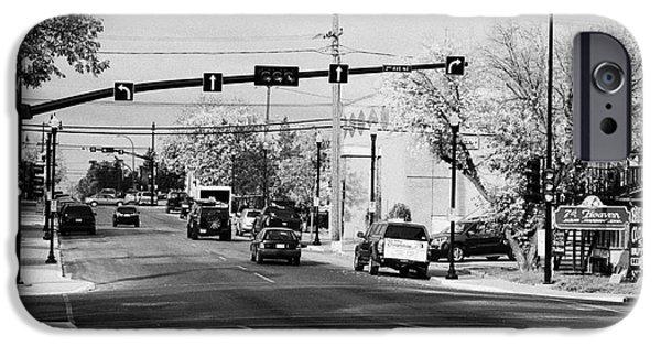 Chaplin iPhone Cases - chaplin street main street through swift current Saskatchewan Canada iPhone Case by Joe Fox