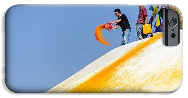 Tibetan Buddhism iPhone Cases - Man throwing orange paint on Boudhanath stupa iPhone Case by Dutourdumonde Photography