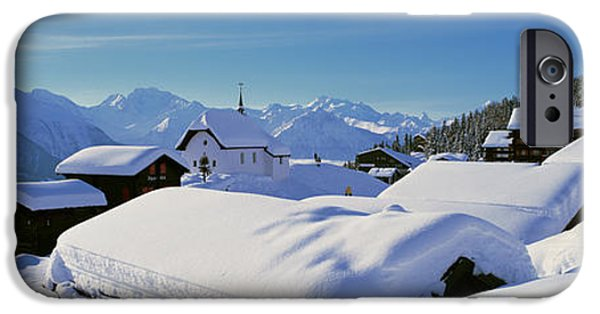Snowy Day iPhone Cases - Snow Covered Chapel And Chalets Swiss iPhone Case by Panoramic Images