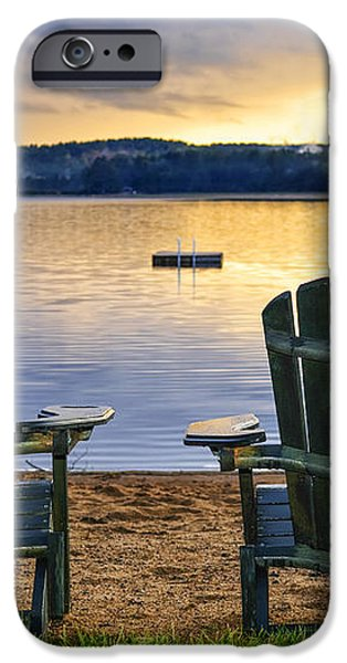 Wooden chairs at sunset on beach iPhone Case by Elena Elisseeva