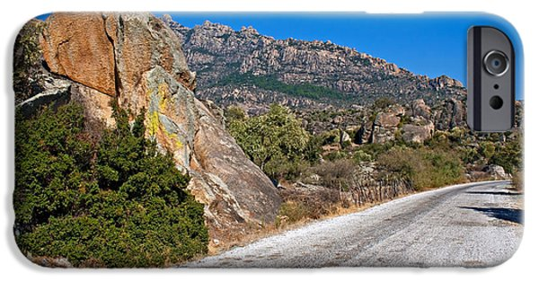 Shape iPhone Cases - Roadway through unusual rock formations on mountain side iPhone Case by Ken Biggs