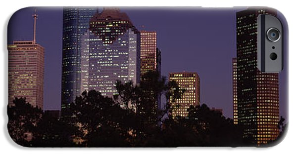 Built Structure iPhone Cases - Buildings In A City Lit Up At Dusk iPhone Case by Panoramic Images