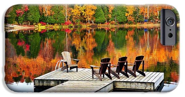 Stillness iPhone Cases - Wooden dock on autumn lake iPhone Case by Elena Elisseeva