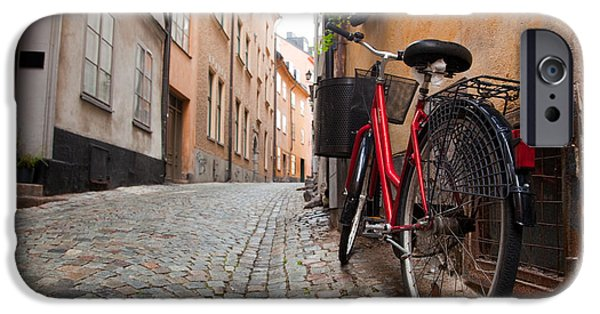 Walls iPhone Cases - A bike in the old town of stockholm iPhone Case by Michal Bednarek