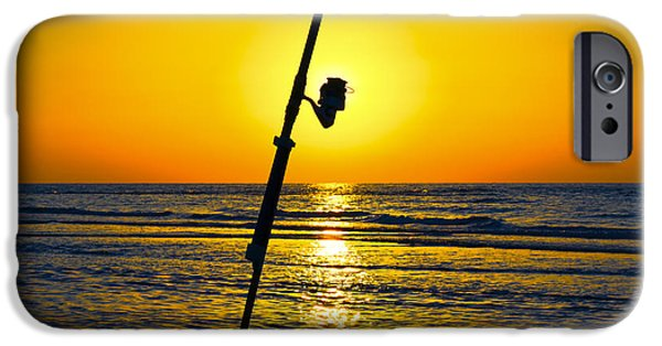 Anticipation Photographs iPhone Cases - A fishing rod on the shore at sunset  iPhone Case by Ido Dromi