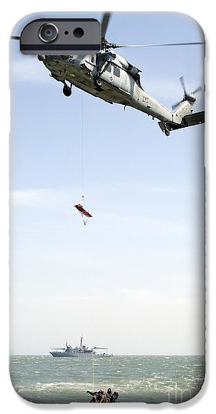 Flight iPhone Cases - A Litter Is Lowered From A Sh-60b iPhone Case by Stocktrek Images