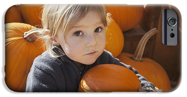 Innocence Child iPhone Cases - A Little Boy Holds One Of Many Pumpkins iPhone Case by Debra Brash
