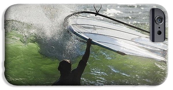 Sail Board iPhone Cases - A Man In The Water Holding Onto His iPhone Case by Ben Welsh