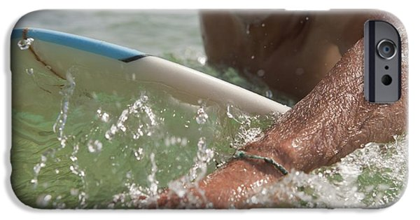 Luz iPhone Cases - A Man Paddling On His Surfboard Off iPhone Case by Ben Welsh
