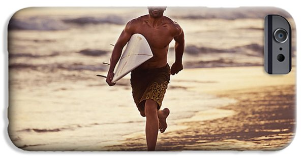 Luz iPhone Cases - A Man Runs On The Wet Beach At Sunset iPhone Case by Ben Welsh