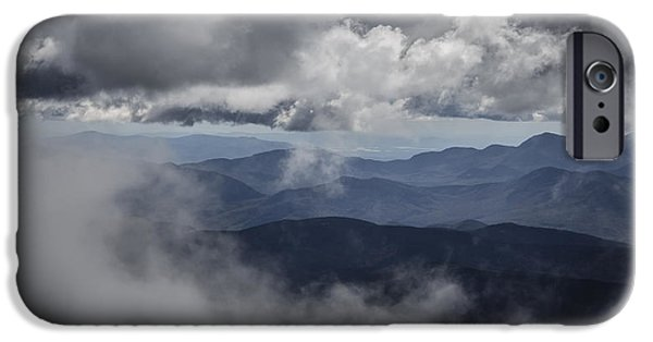 White Mountains iPhone Cases - A peek through the clouds iPhone Case by Chris Fletcher