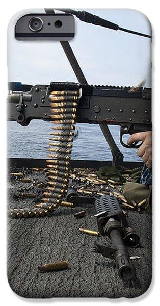 A Sailor Fires An M-240b Machine Gun iPhone Case by Stocktrek Images