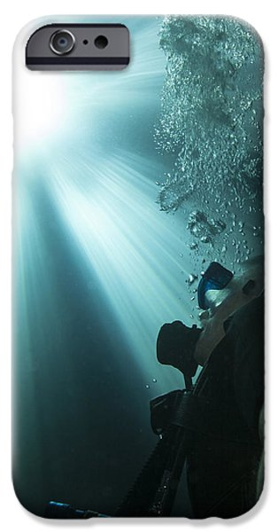 Devil Ray iPhone Cases - A Scuba Diver Surfacing And Looking iPhone Case by Michael Wood