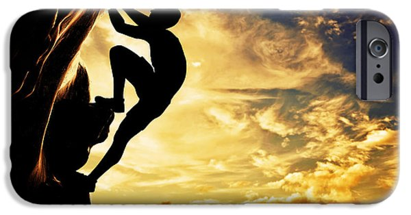 Adrenaline iPhone Cases - A silhouette of man free climbing on rock mountain at sunset iPhone Case by Michal Bednarek