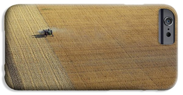 Agriculture iPhone Cases - A Tractor Harvesting Photo iPhone Case by .