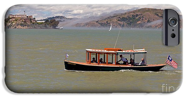 Alcatraz iPhone Cases - A Water Taxi Cruises Past Alcatraz iPhone Case by Jim Fitzpatrick