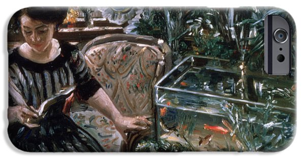 Furniture iPhone Cases - A Woman Reading near a Goldfish Tank iPhone Case by Lovis Corinth