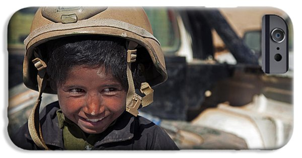 Innocence Child iPhone Cases - A Young Boy Wears A Coalition Force iPhone Case by Stocktrek Images
