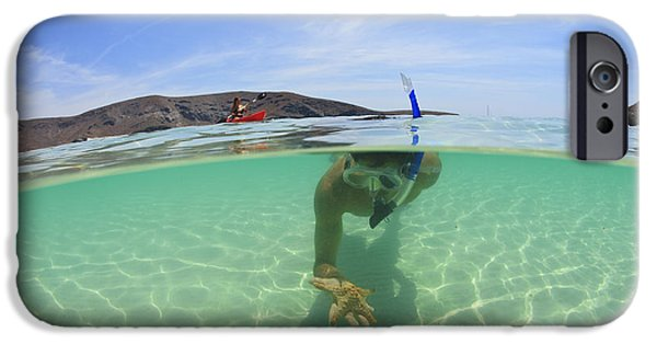 Mature Adult iPhone Cases - A Young Man Snorkeling Underwater iPhone Case by Stuart Westmorland