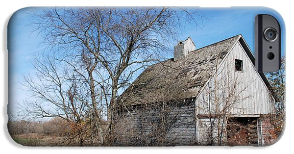 Barns iPhone Cases - An old rundown abandoned wooden barn under a blue sky in midwestern Illinois USA iPhone Case by Paul Velgos